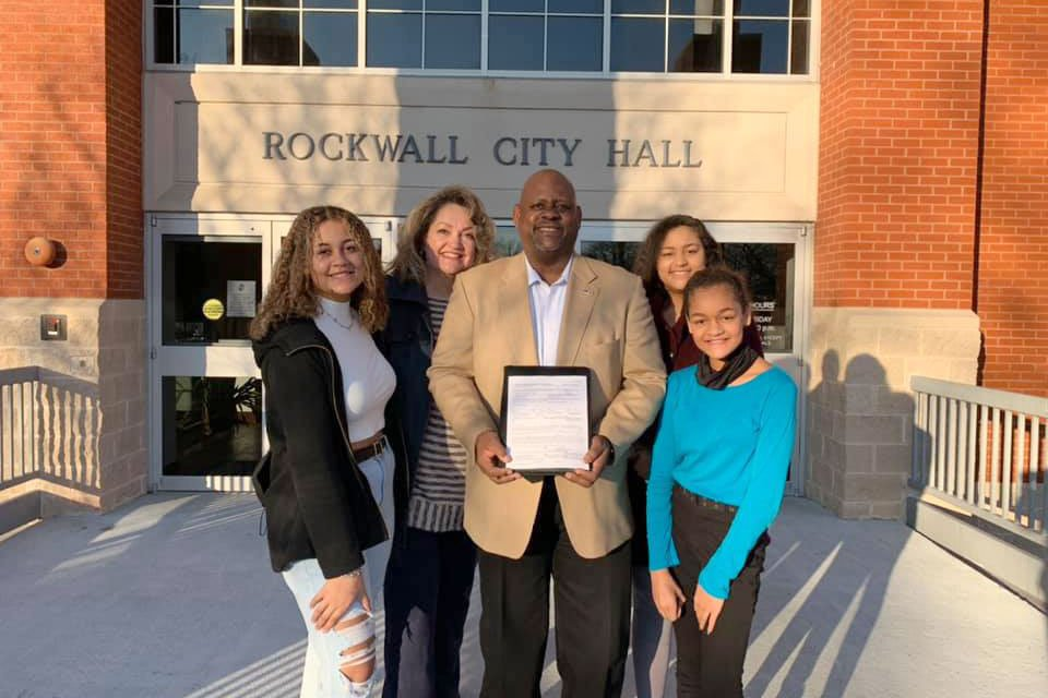 Clarence Jorif with family at city hall